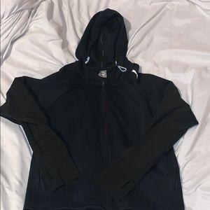 A black puma jacket in womans